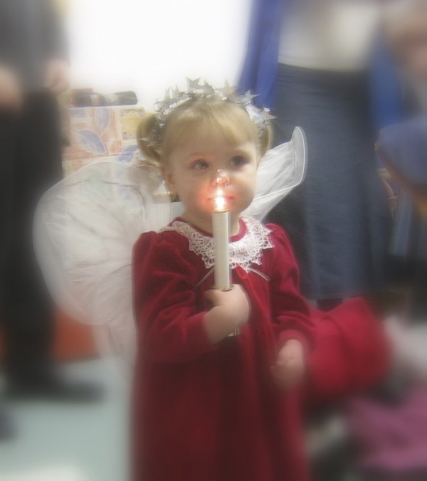 A young girl dressed as an angel participates in the 2010 version of the Newcastle Second Congregational Church's holiday Service of Lessons and Carols. The church is offering a similar program again at 10 a.m. Sunday.