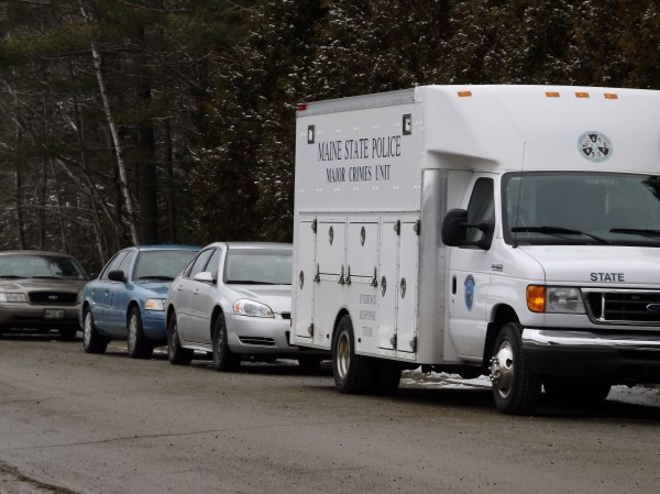 A Maine State Police Major Crimes Unit vehicle and other police vehicles line Whitehouse Road in Vassalboro on Tuesday, Jan. 17, 2012. Rafael Encarnacion of Bronx, N.Y., was shot inside 38 Whitehouse Road by homeowner Joseph Gagnon after an argument early Tuesday morning.
