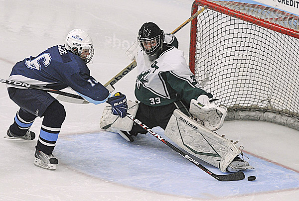 Old Town High School goalie Nathan Colannino makes a save on a shot by Presque Isle High School's Isaac LaJoie during the second period in Orono. Tuesday night.