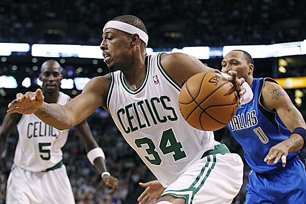 Boston Celtics forward Paul Pierce (34) drives past Dallas Mavericks forward Shawn Marion (0) while Celtics forward Kevin Garnett (5) watches during the first quarter of an NBA basketball game in Boston on Wednesday night. The Mavs won 90-85.