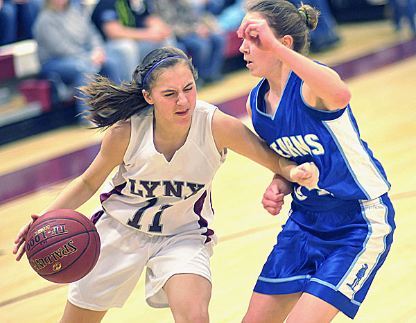 Mattanawcook guard Harley Maxwell (11) tries to muscle past Stearns' Sigrid Koizar (34) in the first half of their game in Lincoln, Maine Thursday Jan. 26, 2012.