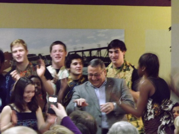 Gov. Paul LePage dances with the Colby African Drumming Ensemble during the 26th annual Martin Luther King, Jr. Community Breakfast at the Muskie Community Center in Waterville on Monday, Jan. 16, 2012.