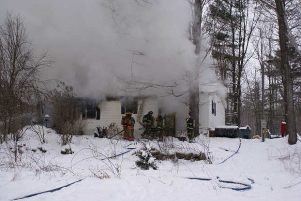 Fire crews worked to battle a blaze at 187 Cleve Trapp Road in Poland about 11 a.m. Saturday. A father and two children were able to escape but the house was destroyed and two dogs perished in the fire, according to fire officials.