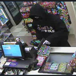 Man robs convenience store at gunpoint, remains at large