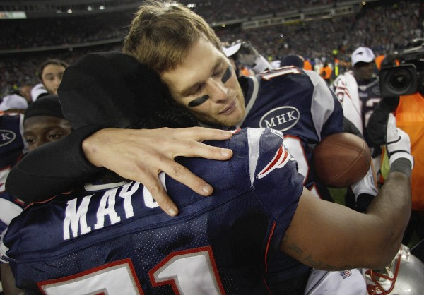 New England Patriots quarterback Tom Brady (12) hugs middle linebacker Jerod Mayo (51) after an AFC Championship NFL football game Sunday, Jan. 22, 2012, in Foxborough, Mass. The Patriots defeated the Ravens 23-20 to win the AFC Championship.