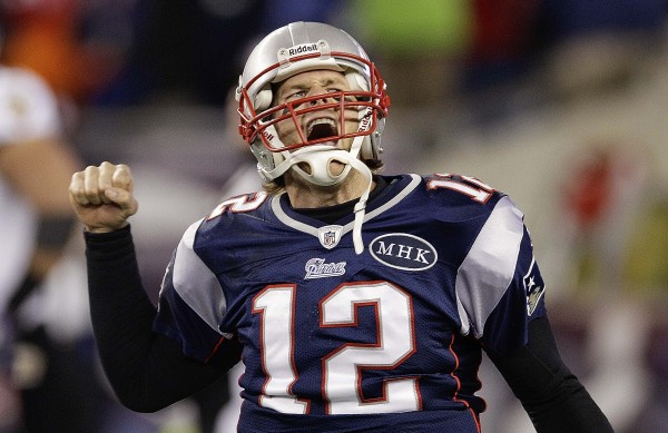 New England Patriots quarterback Tom Brady (12) celebrates after scoring a one yard touchdown during the second half of the AFC Championship NFL football game against the Baltimore Ravens Sunday, Jan. 22, 2012, in Foxborough, Mass.