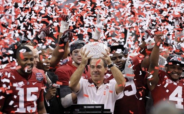 Alabama head coach Nick Saban celebrates with his team after the BCS National Championship college football game against LSU Monday night, Jan. 9, 2012, in New Orleans. Alabama won 21-0.
