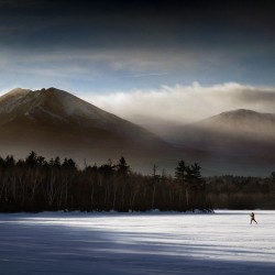Ken Spalding of Wayne explores Katahdin Lake as storm clouds clear over mile-high Mount Katahdin in Baxter State Park in 2007.