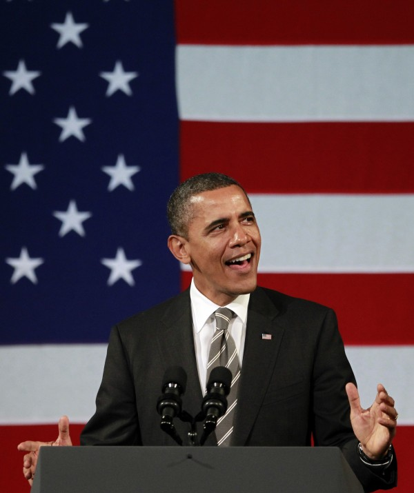 President Barack Obama sings before speaking at a campaign event, Thursday, Jan. 19, 2012, at the Apollo Theatre in the Harlem neighborhood of New York.
