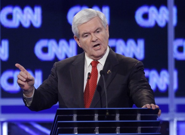 Republican presidential candidate former House Speaker Newt Gingrich reacts to a question at the start of the Republican presidential candidate debate at the North Charleston Coliseum in Charleston, S.C., Thursday, Jan. 19, 2012.
