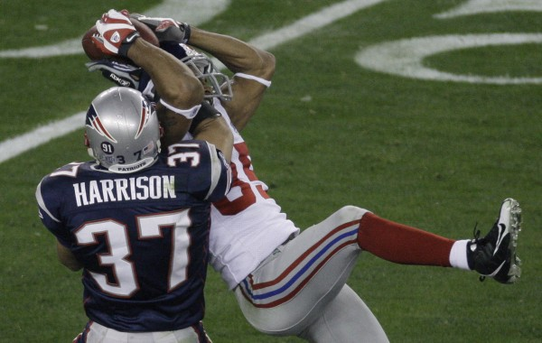 New York Giants receiver David Tyree (right) makes a catch against New England Patriots safety Rodney Harrison (37) during the fourth quarter of the Super Bowl XLII football game at University of Phoenix Stadium on Sunday, Feb. 3, 2008 in Glendale, Ariz.