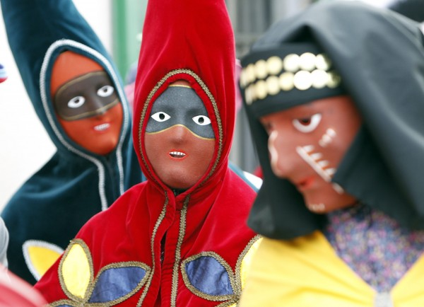 Nuessler, men or boys in traditional costumes and masks that are derived from those worn by the characters in the Venetian Commedia dell' Arte, parade through the streets of Brunnen, Switzerland on Monday, Jan.  9, 2012, marking the opening of the carnival season.