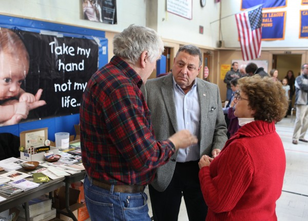 Gov. Paul LePage (center) speaks with Rep. Paul Davis (left), R-Sangerville, and his wife Patty Davis, on Saturday, Jan. 14, 2012, at an anti-abortion rally in Augusta as part of the annual &quotHands Around the Capitol&quot rally and march.