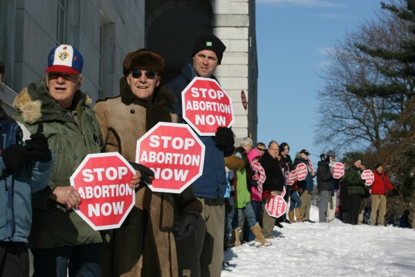 Participants in the annual anti-abortion rally surround the state house Saturday, Jan. 14, 2012 in Augusta, Maine for the &quotHands Around the Capitol Rally and March.&quot The rally is held each year to recognize the anniversary of the Supreme Court's Roe vs. Wade decision.