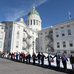 300 anti-abortion activists encircle state Capitol
