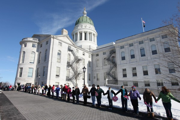 Participants in the annual anti-abortion rally surround the state house Saturday, Jan. 14, 2012, in Augusta for the &quotHands Around the Capitol&quot rally and march.