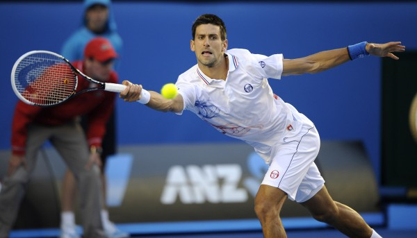 Novak Djokovic of Serbia hits a forehand return to David Ferrer of Spain during their quarterfinal at the Australian Open tennis championship, in Melbourne, Australia, Wednesday, Jan. 25, 2012.
