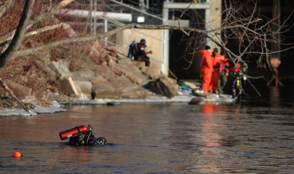 A Maine Game Warden diver searches the waters of the Kennebec River near Waterville on Wednesday, Jan 11, 2012 for Ayla Reynolds.
