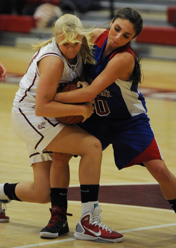 Bangor's Liz Hintz and Messalonskee's Mary Badeen scrap for a loose ball during first period action on Tuesday, Jan 24, 2012 at Bangor High School.