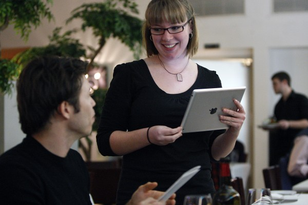 A server uses an iPad to take a table's order at CholaNad in Chapel Hill, North Carolina, on January 18, 2011. (Travis Long/Raleigh News & Observer/MCT)
