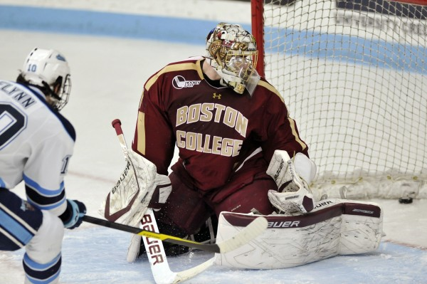 Maine center Brian Flynn (10) scores on Boston College goalie Brian Billett (1) in the first period of their college hockey game against Maine, Saturday, Jan. 21, 2012, in Orono, Maine.