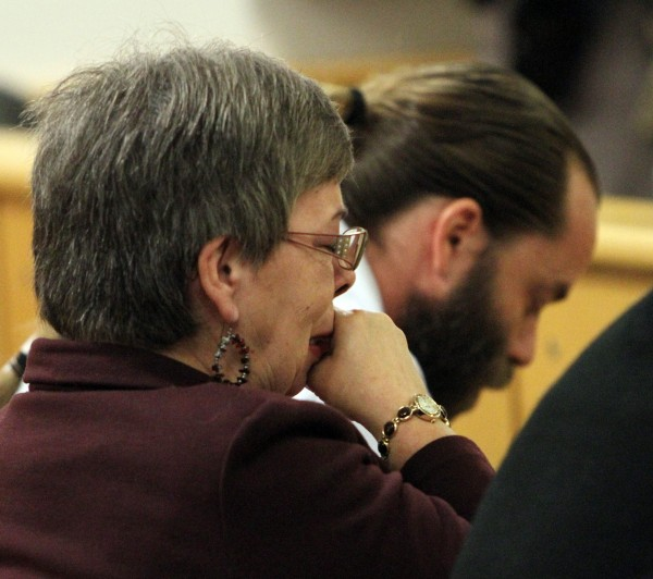 Julianne McCrery's mother (left), Lu Rae McCrery, and McCrery's brother Christoper Hughes listen as prosecutors explain how 6-year-old Camden Hughes was killed during a sentencing hearing  in Rockingham County Superior Court on Friday, Jan. 13, 2012 in Brentwood, N.H.