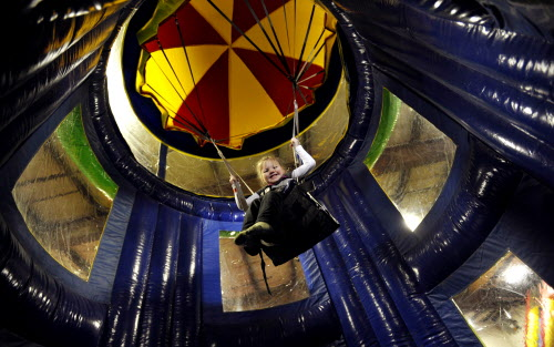 Brynn Lavigueur, 4, of Brewer, has fun on a parachute ride called the &quotAirborne Adventure&quot on Wednesday, Jan. 18, 2012 at Playland Adventures on Wilson Street in Brewer.