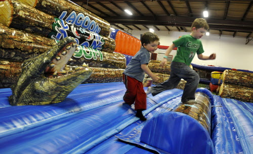 Cousins J.D. Williams, 2, (left) and Kaiden Clark, 5, of Belfast, play in the Lagoon of Doom on Wednesday, Jan. 18, 2012 at Playland Adventures on Wilson Street in Brewer.