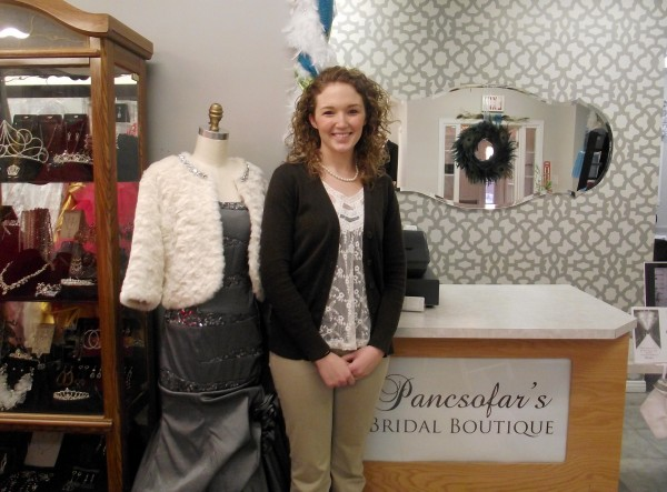 Courtney Wetzel, a Mars Hill resident and the new owner of Pancsofar's Bridal Shop in Presque Isle, stands in the entrance on Thursday, Dec. 29, 2011. The 23-year-old has seen record sales since taking over the business in November and has introduced new products to cater to the tastes of her clientele.