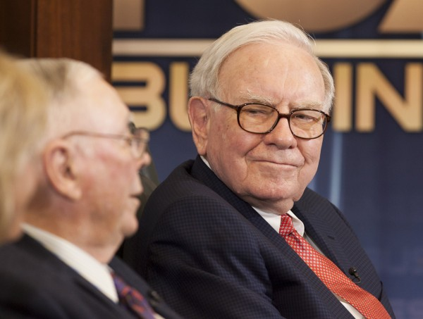Warren Buffett (right), chairman and CEO of Berkshire Hathaway looks to his vice chairman Charlie Munger during an interview on the Fox Business Network with Liz Claman, in Omaha, Neb., Monday, May 2, 2011.