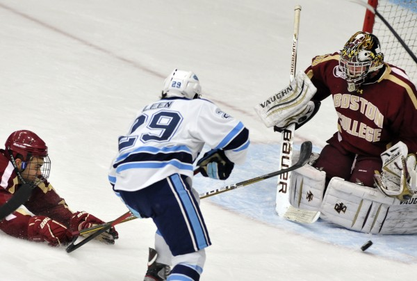 Boton College defenseman Isaac MacLeod (7) makes a diving stab at a loose puck ahead of Maine winger Connor Leen (29) in front of Boston College goalie Chris Venti (30) in the first period of their NCAA college hockey game, Friday, Jan. 20, 2012, in Orono, Maine.