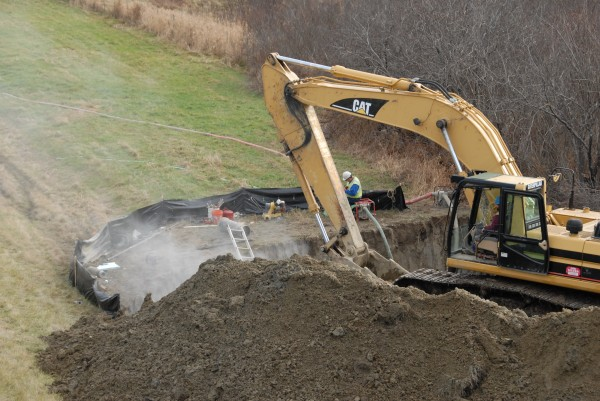A construction crew from Lou Silver Inc. installs a 12-inch water line alongside Interstate 395 and the Green Point Road in Brewer in early December.