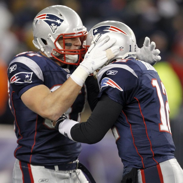 New England Patriots tight end Rob Gronkowski, left, celebrates his 19-yard touchdown reception with quarterback  Tom Brady during the first half of an NFL divisional playoff game Saturday night, Jan. 14, 2012, in Foxborough, Mass.