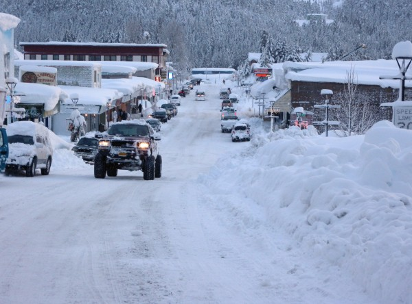 In this Saturday, Jan. 7, 2012 photo provided by the Alaska Division of Homeland Security and Emergency Management, vehicles move down snow-covered streets in the fishing town of Cordova, Alaska.