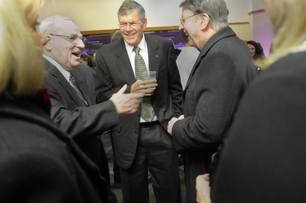 John Bragg (center), chairman of the board of Bangor-based N.H. Bragg, catches up with Jim Dowd (left) and Dr. Shaun N. Dowd (right) during the reception preceding the annual Bangor Region Chamber of Commerce Dinner at the Bangor Civic Center Thursday evening, Jan. 19, 2012. Bragg is this year's recipient of the chamber's Norbert X. Dowd Award for his contributions to Greater Bangor's economy and quality of life. The Dowd brothers are the sons of the late Norbert X. Dowd.