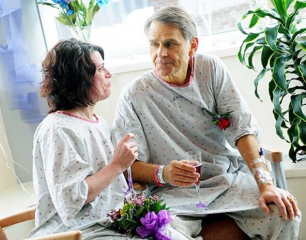 Barry Hanson looks to his new wife, Pam LaFreniere, after their wedding at Central Maine Medical Center on Tuesday.
