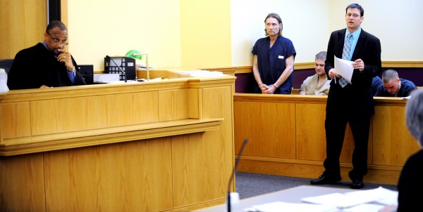 Justice Rick E. Lawrence (left) and public defender Richard Charest (right) look to prosecutor Patricia Reynolds Regan for comment during an appearance by Kelly Zuhlke (center) in 8th District Court on Friday. Zuhlke was arrested on a fugitive from justice warrant and is expected to be extradited to face criminal charges in Wisconsin and Montana.