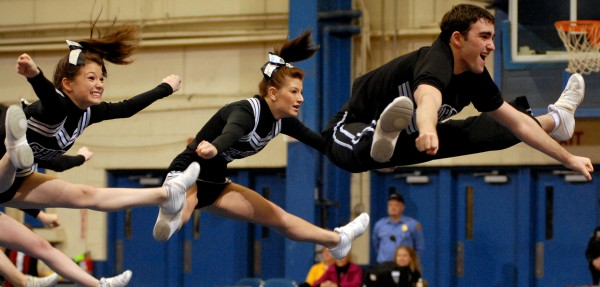The Houlton cheering squad performs a toe touch in its routine at last year's state championships. Houlton won the Class C title and begins its title defense Saturday when the Eastern Maine regionals are held in Bangor.