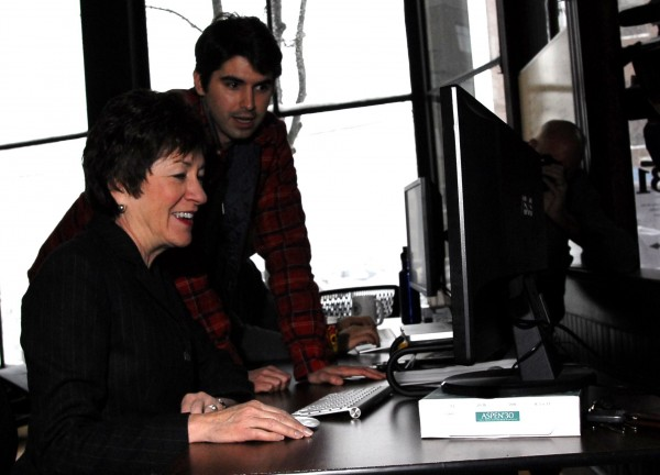 Charlie White of CashStar shows Sen. Susan Collins a project to incorporate digital gift-giving into a social media setting on Jan. 12, 2012.
