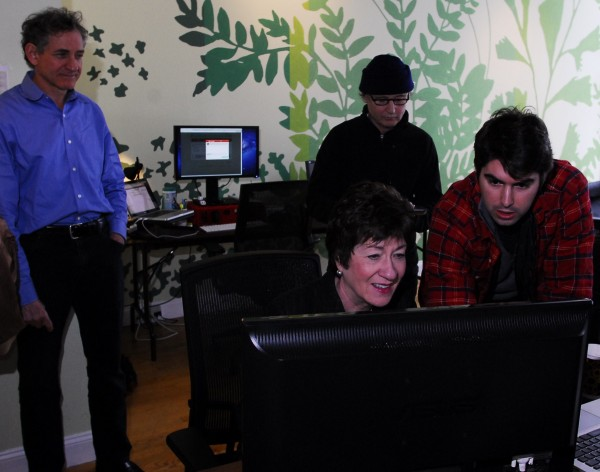 Charlie White of CashStar shows Sen. Susan Collins a project to incorporate digital gift-giving into a social media setting on Jan. 12, 2012, as CEO David Stone (left) looks on. Behind Collins and White is a videographer taping the visit for the company.