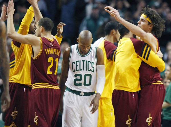 Boston Celtics' Ray Allen (20) heads off the court as the Cleveland Cavaliers Anderson Varejao, right, and Mychel Thompson (21) celebrate the Cavaliers' 88-87 win in an NBA basketball game in Boston, Sunday, Jan. 29, 2012.