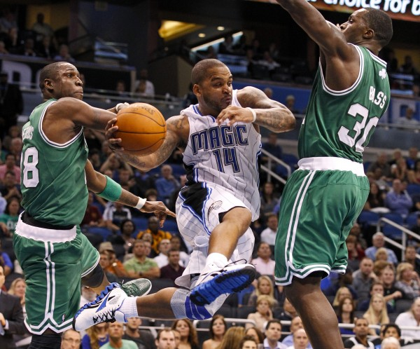 Orlando Magic's Jameer Nelson, center, tries to drive between Boston Celtics' Mickael Pietrus, left, and Brandon Bass during the second half of an NBA game on Thursday, Jan. 26, 2012, in Orlando, Fla. The Celtics won 91-83.
