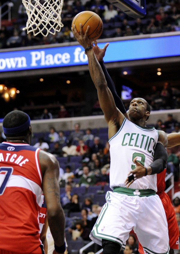 Boston Celtics guard Rajon Rondo, right, goes to the basket against Washington Wizards forward Andray Blatche (7) during the first half of an NBA game, Sunday, Jan. 1, 2012, in Washington.