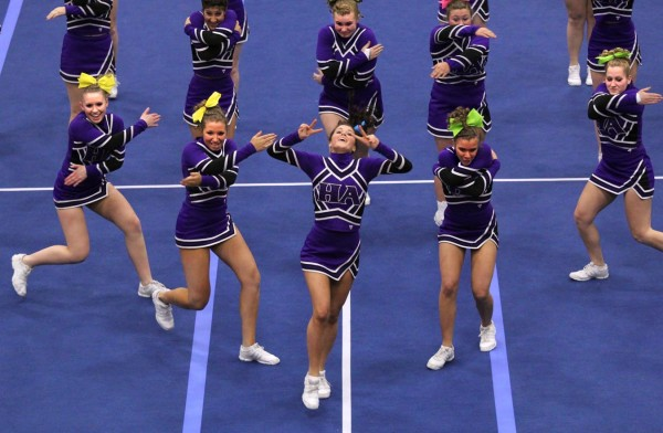 The Hampden Academy cheerleading squad performs its routine during the Class A Regional Cheerleading Competition at the Augusta Civic Center on Saturday night. Hampden Academy finished fifth with 137 points to qualify for the state championship in Augusta on Feb. 11.