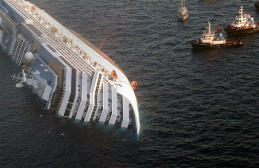 In this photo released by the Guardia di Finanza (border Police), the luxury cruise ship Costa Concordia leans on its side after running aground off the tiny Tuscan island of Giglio, Italy, Saturday, Jan. 14, 2012.