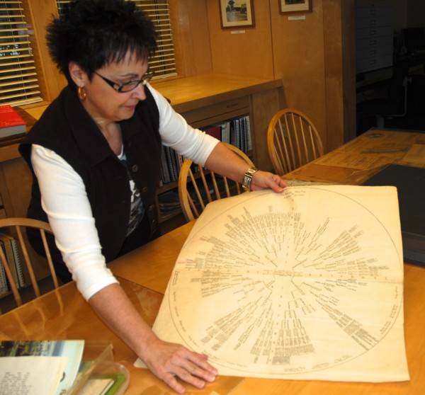 Anne Chamberlain, administrative assistant with the Acadian Archives at the University of Maine at Fort Kent, displays a family tree compiled by Leon Guimond of Frenchville.