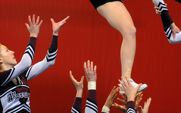 The Nokomis Regional High School cheering squad performs their routine during the Class B Regional Cheerleading Competitions in Bangor Saturday.