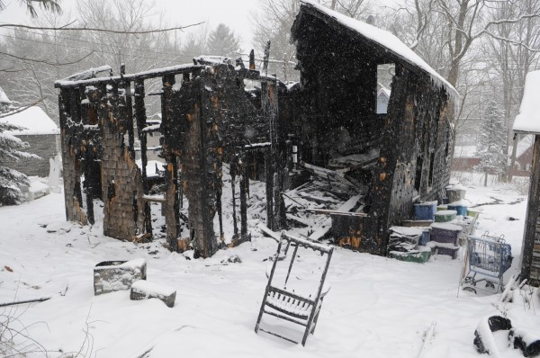 Fire crews from five towns responded to a fire Friday morning, Jan. 20, 2012, that destroyed a building at Camp Etna on Dover Street. Capt. Aaron Brown of the Etna Fire Department said he received the call at 5:30 a.m.