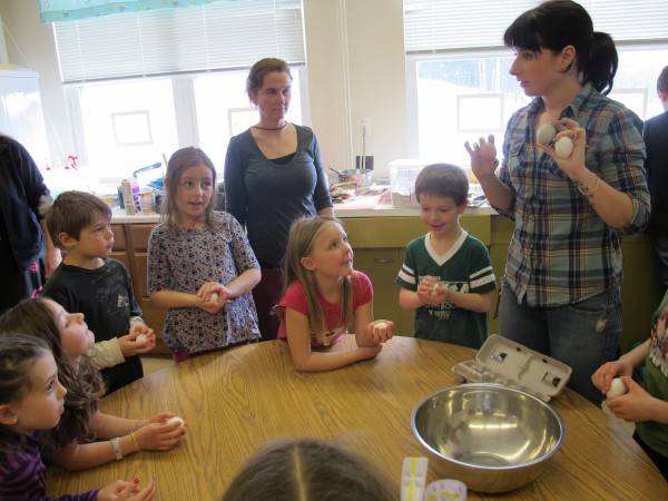 Erin Dow teaches the students in Jinny Bryant's first and second grade class how to properly crack eggs at Winthrop Grade School on Wednesday, Jan. 18, 2012.