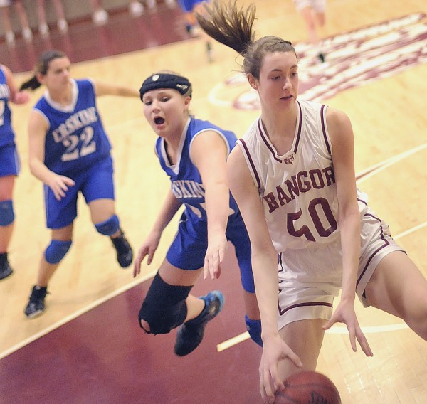 Erskine girl's basketball player Ashlee Crowell-Smith can't get to Bangor player Cordelia Stewart (50) along the baseline in the first half of their game in Bangor on Friday Jan. 13, 2012.